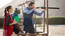 A Couple Aiming at the Shooting Clay