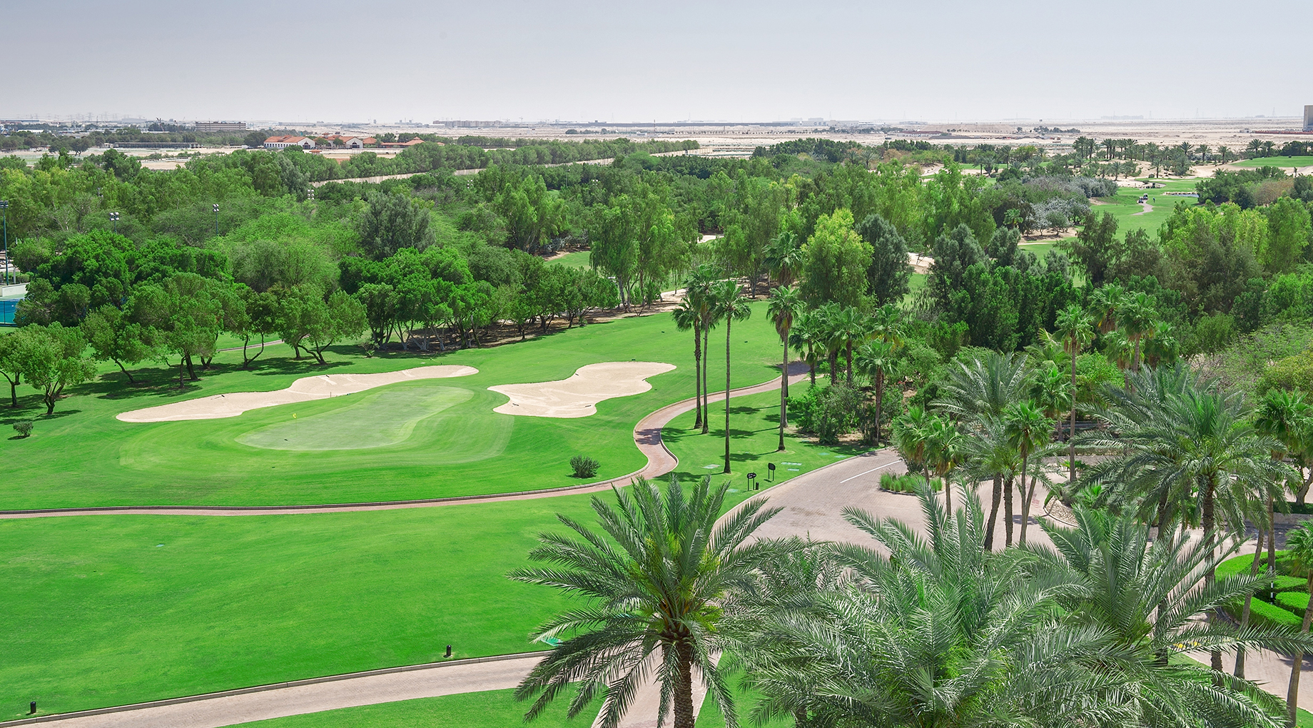 Aerial view of the golf course at JA Jebel Ali Golf Resort