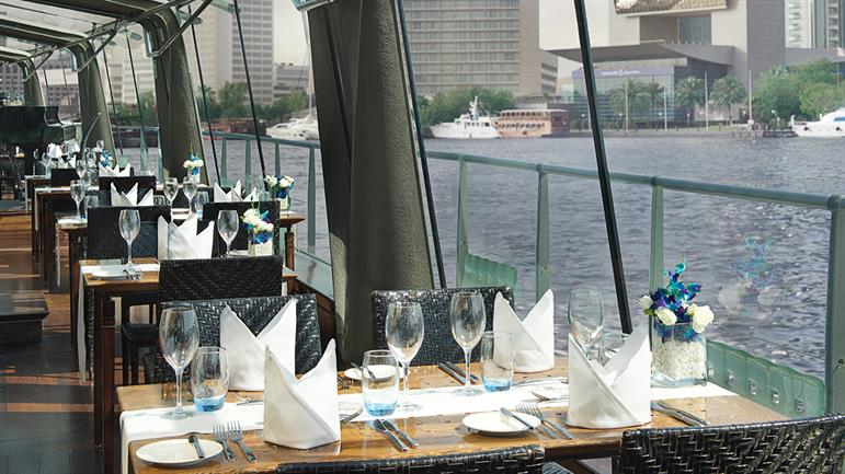 Bateaux-Dubai---Window-dining-area.jpg